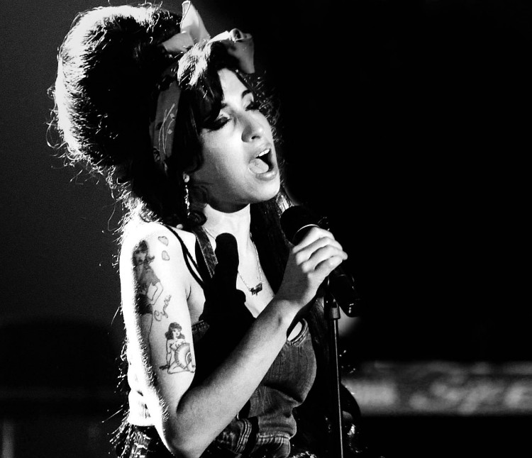 File photo shows singer Amy Winehouse performing during the MTV Europe Awards ceremony in Munich