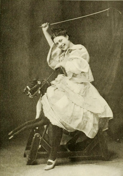 Holiday Spirit, 1904. Edwardian girl on rocking horse.