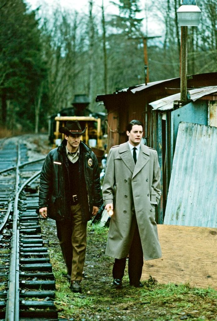 UNITED STATES - APRIL 08:  TWIN PEAKS - Pilot - Season One - 4/8/1990, Homecoming queen Laura Palmer is found dead, washed up on a riverbank wrapped in plastic sheeting. FBI Special Agent Dale Cooper (Kyle MacLaughlin, right) is called in to work with local Sheriff Harry S.Truman (Michael Ontkean) in the investigation of the gruesome murder in the small Northwestern town of Twin Peaks. ,  (Photo by ABC Photo Archives/ABC via Getty Images)