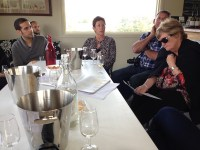 People wine tasting at Hedberg Hill Wines, Orange Wine Tours