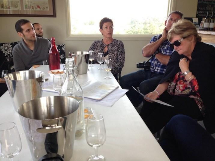 People wine tasting at Hedberg Hill Wines, Orange Wine Tours