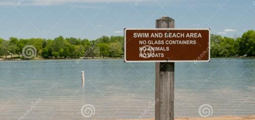 beach-signage-sign-near-shoreline-31338154