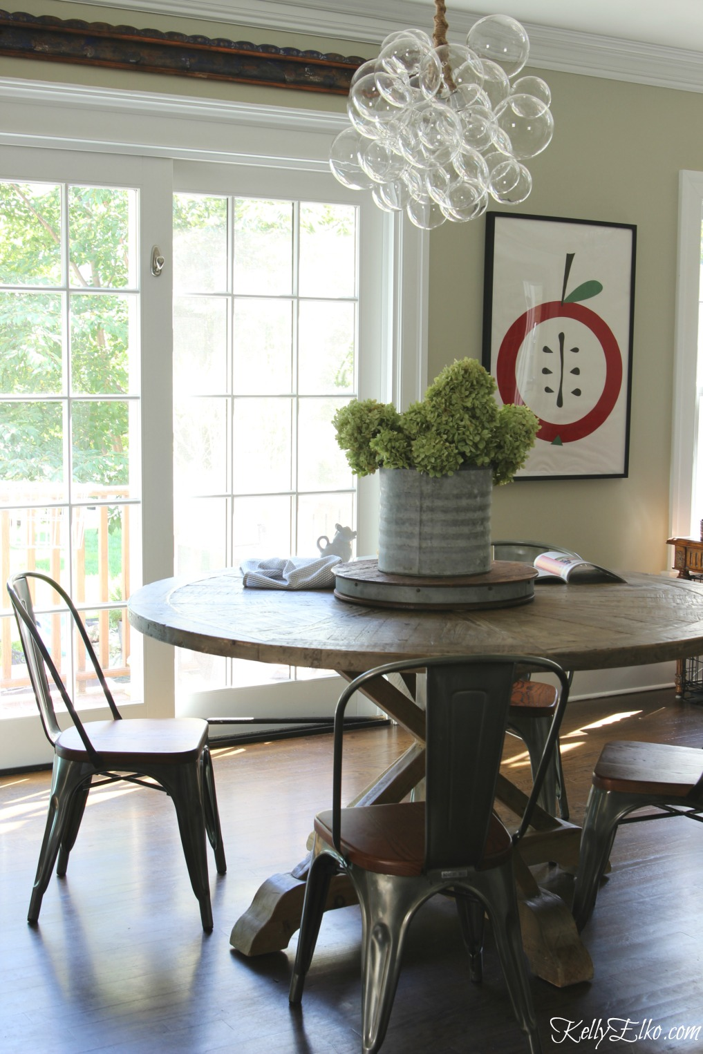 chandelier buying tips kitchen table chandelier Wow love the modern bubble chandelier paired with farmhouse kitchen table kellyelko com