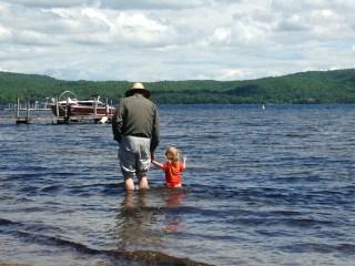 Grandpa Luke and Dillon looking at the boats on Lake Champlain.