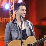 Andy Grammer talking with the cast