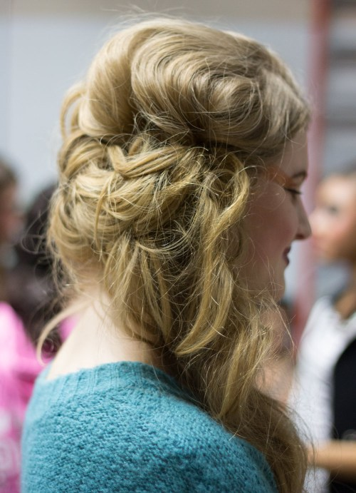 """{Secured updos that still have mega volume? This is called """"the best of both worlds."""" The messy braid keeps the look relaxed while keeping the tresses out of the face.}"""