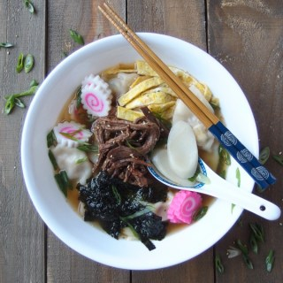 Manduguk - Korean Dumpling Soup is traditionally eaten on New Years Day. It's made from a beef, kelp, and anchovy stock and topped with rice cakes, kamaboko, eggs, nori, and marinated skirt steak. A delicious way to welcome the new year! SO good! |www.kimchichick.com