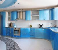 A Metallic Blue Kitchen with Modern Curved Cabinets