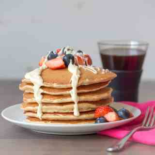Coconut pancakes with berries and white chocolate