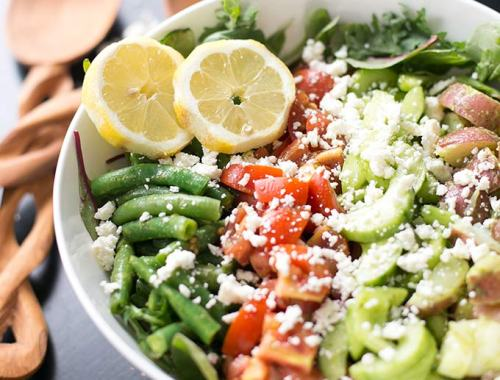 This Spring Salad with Cilantro Vinaigrette combines fresh vegetables with a zesty vinaigrette for a healthy and refreshing meal.