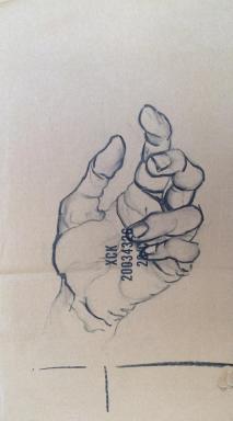Drawing Hand on Cardboard