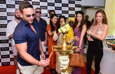 Adam Collins lighting the lamp at Page 3 Salon in the presence of Models Decca Agatha, Hannah, Designer Chirawan Lewis, Ivan, Actor Darren, CK Kumaravel & Veena