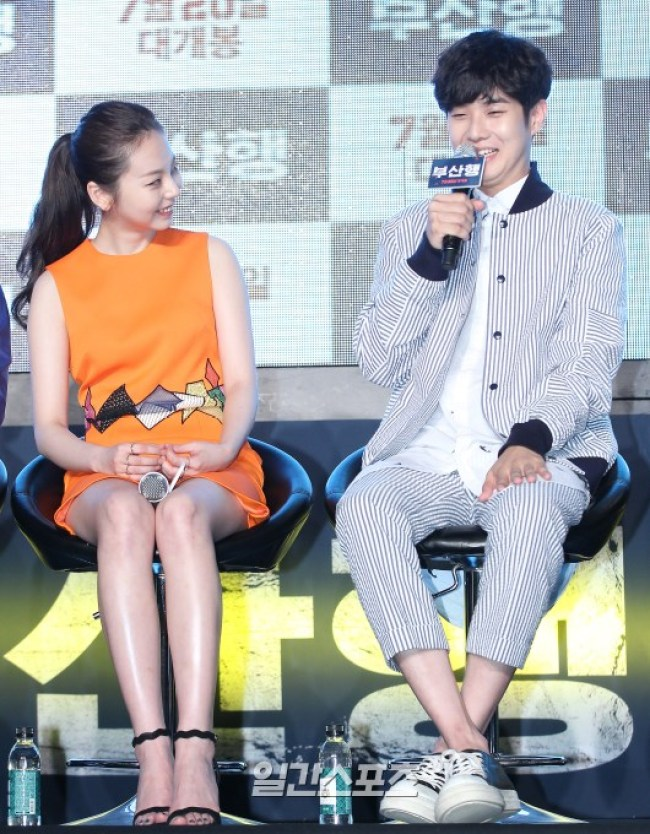 Image: Sohee looks on as Choi Woo Sik speaks to the press
