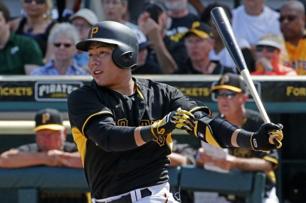 Pittsburgh Pirates' Kang Jung-ho of South Korea hits a double during a spring training exhibition baseball game against the New York Yankees in Bradenton, Fla., Thursday, March 5, 2015.  (AP Photo/Gene J. Puskar)