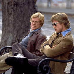 Robert Redford and Brad Pitt talk shop in the CIA thriller Spy Game.