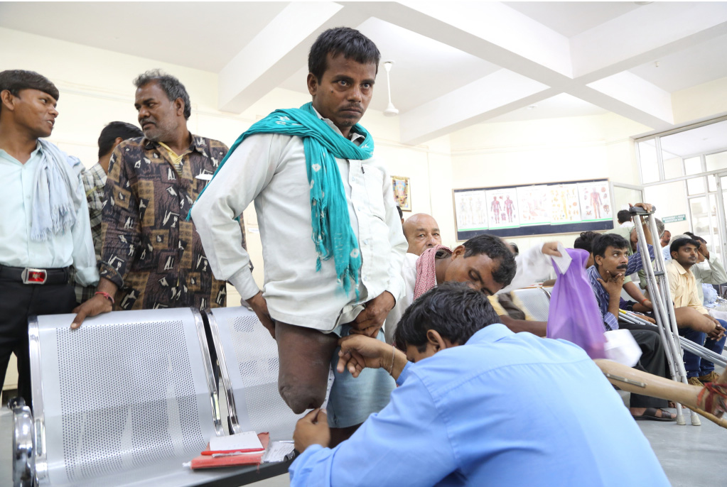 "A man gives measurement for his ""Jaipur Knee"" prosthetic."