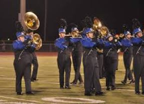 Wildcats Marching Band's Percussion and Color Guard got a Four-Day Jump