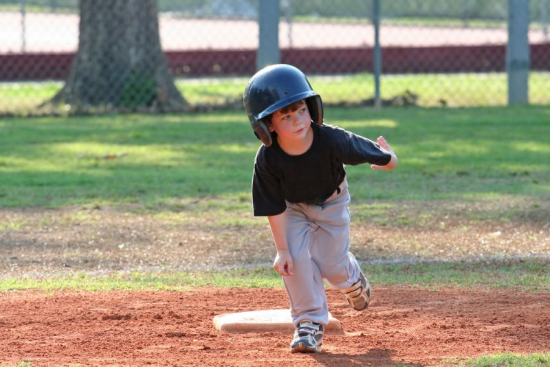 child playing tball