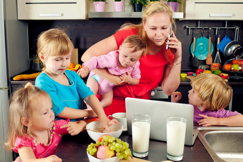 Mother and her children on the kitchen