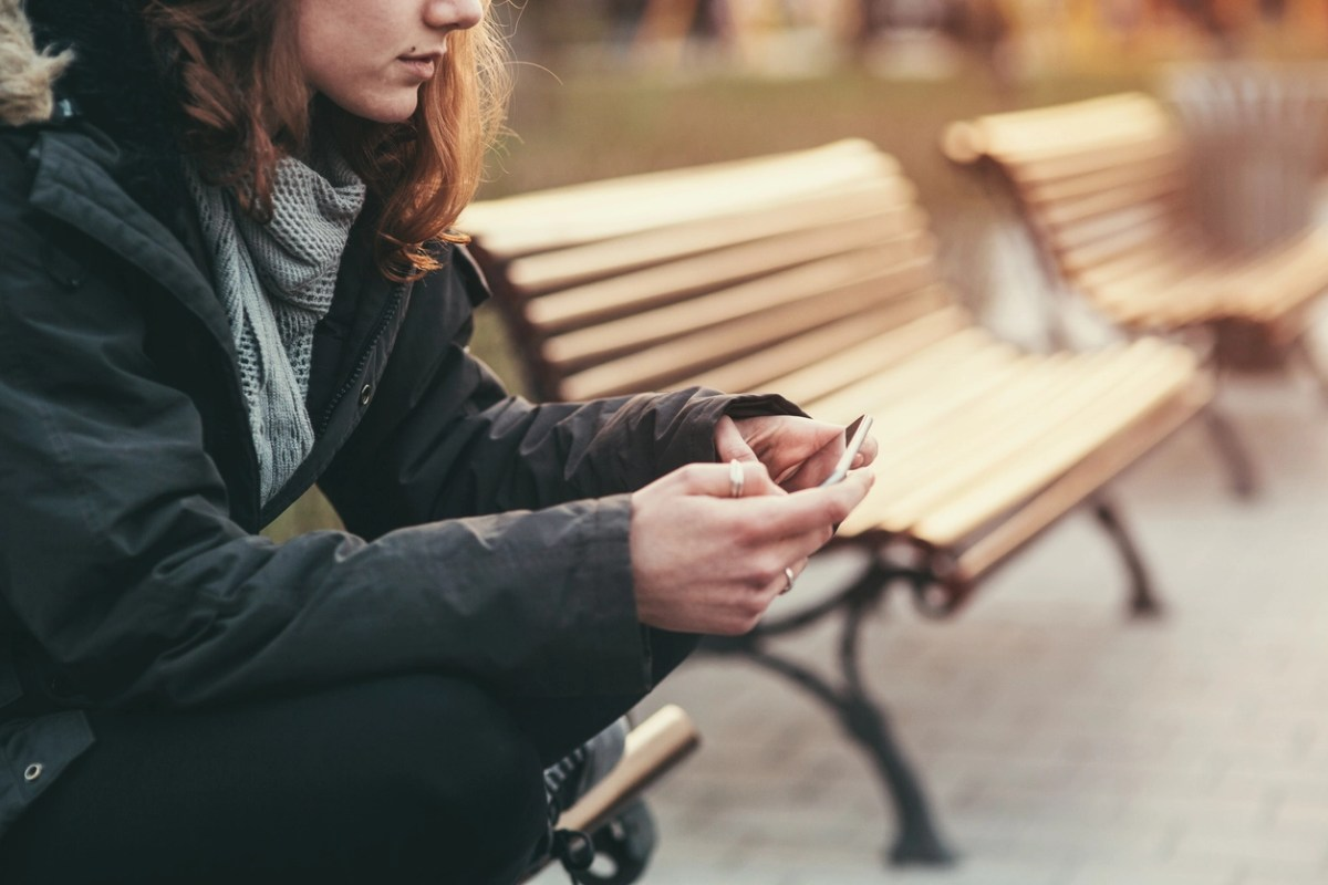 Teenage girl feeling depressed after breaking up with her boyfriend through messages