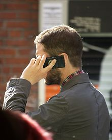 220px-Man_speaking_on_mobile_phone