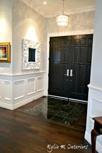 Entryway with dark wood flooring, black marble tile and ...