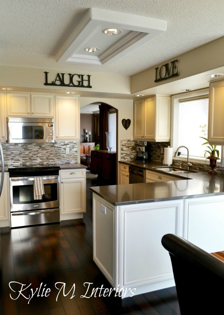 cream kitchen cabinets and dark wood floor in kitchen neutral