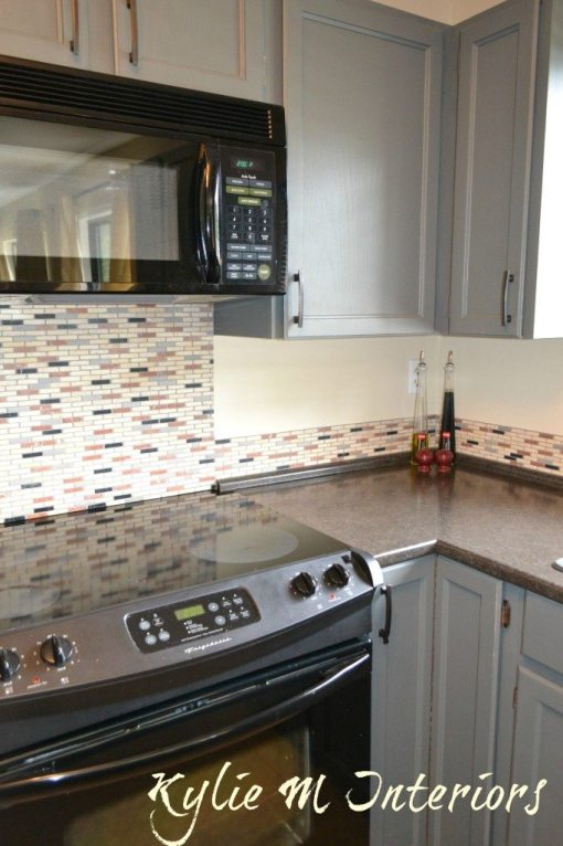 cream, black and rust backsplash tile with gentle cream walls.jpg short backsplash