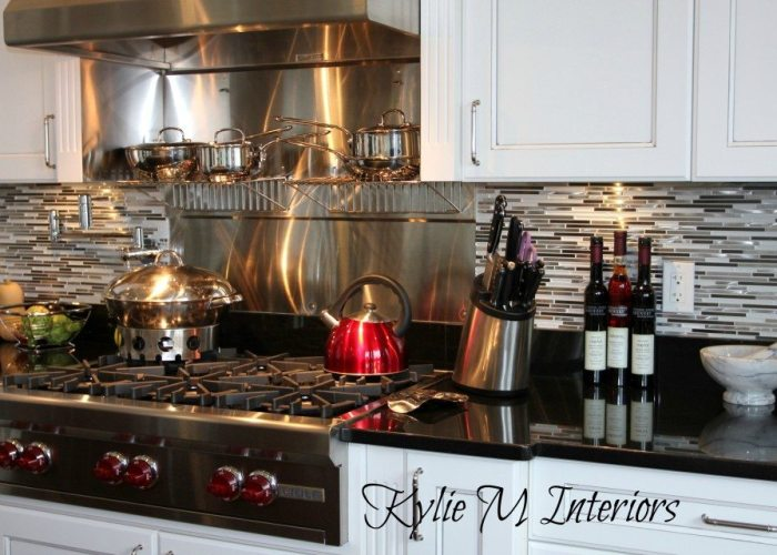 glass and stainless steel mosaic backsplash, white cabinets with pewter glaze
