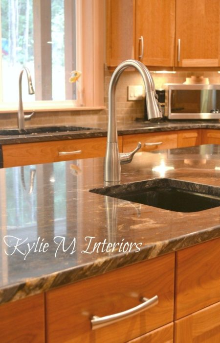 prep sink faucet coordinating with sink faucet, cherry cabinets and black granite countertops