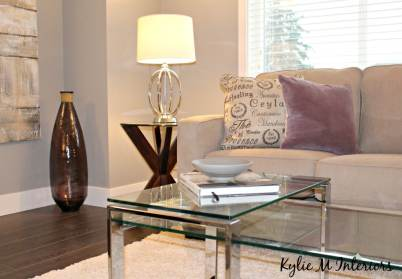 home staging ideas for living room with gray paint, chrome and glass and cream shag rug