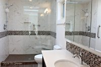 walk in shower in bathroom with pink and brown mosaic tile ...