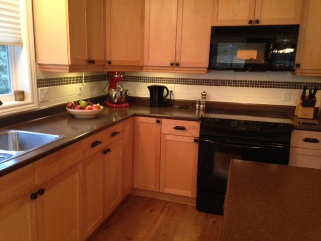 Maple kitchen before cabinets were painted and new countertop and