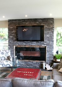 Rustic ledgestone fireplace with reclaimed wood surround ...