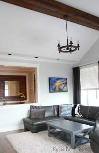 living room with vaulted ceiling, fake, faux wood beam ...