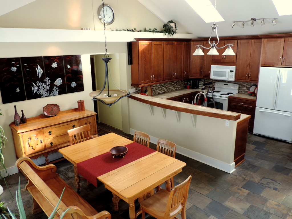 kitchen and dining with vaulted ceiling