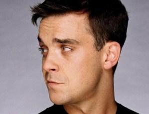Robbie Williams, show da musical e duetto col padre