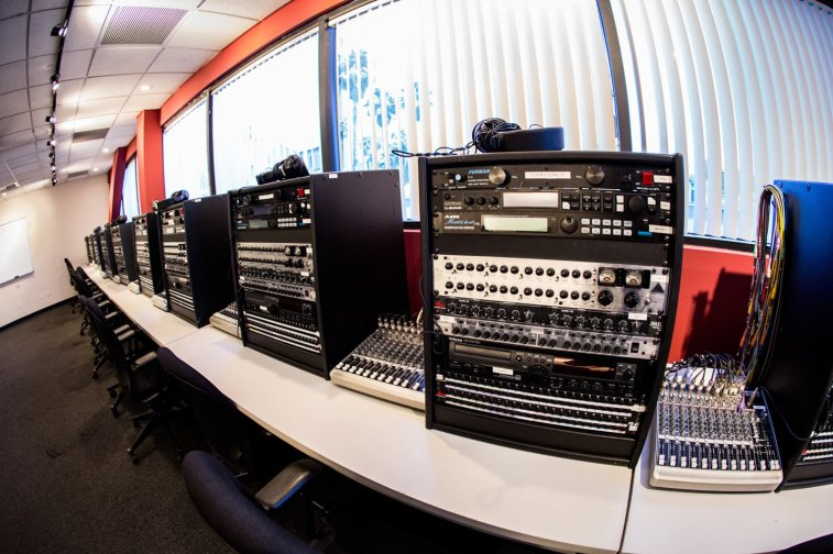 The Outboard Lab is specifically designed to train beginning audio students in the use of outboard signal processing equipment. The room features 20 student stations featuring equipment from TC Electronics, DBX, and Aphex among others, and includes Tascam CD recorders for students to record their results for further study. The stations are fed audio from a central Avid Pro Tools system that instructors use to lead the class in various exercises.