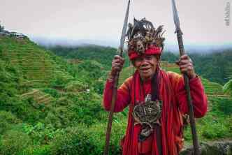Ifugao man in traditional costume, not worn on a daily basis any more but now a form of income (take a picture, and pay for it).