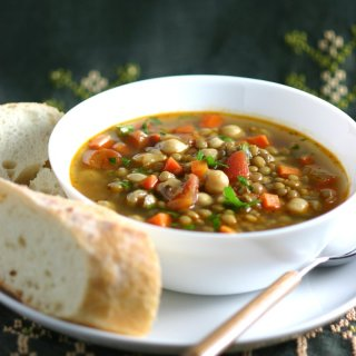 This Middle Eastern Green Lentil Soup features tender lentils, hearty chickpeas, and a spiced broth. Serve as is or stir in some chopped greens.