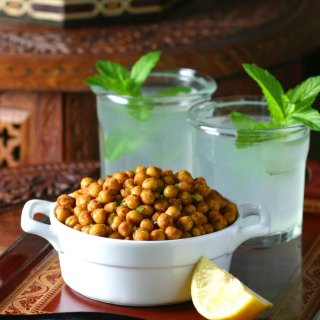 The perfect high protein snack, Falafel Spiced Roasted Chickpeas are crunchy, spicy, and feature all the flavor of falafel with very little effort.