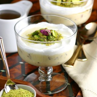 A very popular dessert throughout the Middle East, Lebanese Semolina Pudding (Layali Lubnan) includes sweet-tart cranberries, thick coconut cream, ground pistachios, and a floral-scented syrup. This vegan recipe can be made in under 20 minutes, then it chills in the fridge until you are ready to dig in.