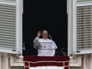 Pope Francis waves before delivering his Angelus prayer from the window of his studio overlooking St. Peter's Square, at the Vatican, Sunday, March 17, 2013. (AP Photo/Michael Sohn)