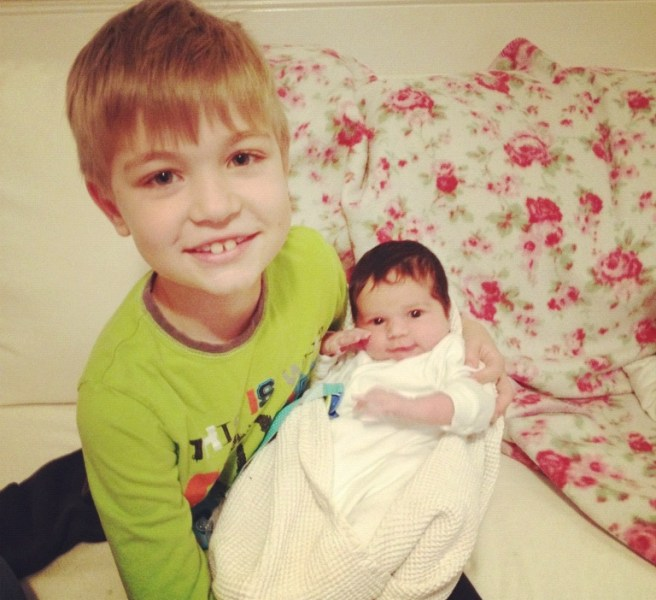 Eddie is the proud big brother with 8 day old Isobel