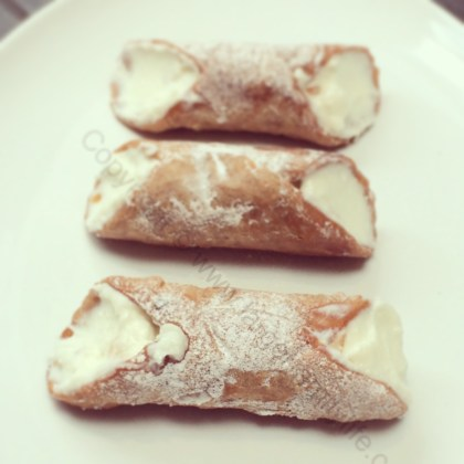 3 cannoli on plate