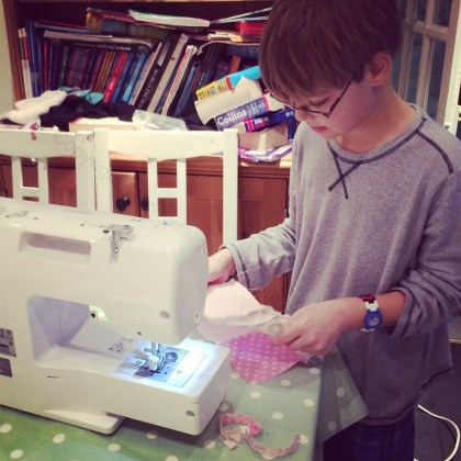 Eddie doing some evening sewing on his machine...