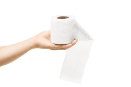 Female hand holding a roll of toilet paper