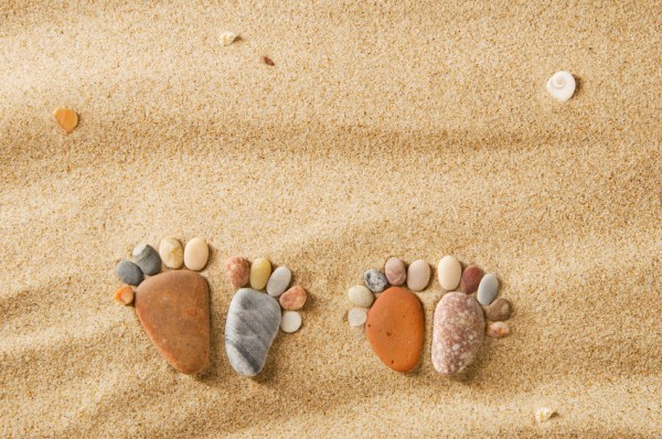 stone footprints in sand