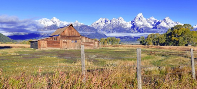 Vintage Barn and Grand Teton and the Teton Range, a popular peak to climb for mountain climbers in Grand Teton National Park, Wyoming, USA
