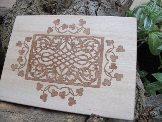 Laser cut Walnut veneer inlay in Birch